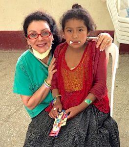 Dr. Diana Kyrkos, of Catawba Island, comforts a young Mayan patient
