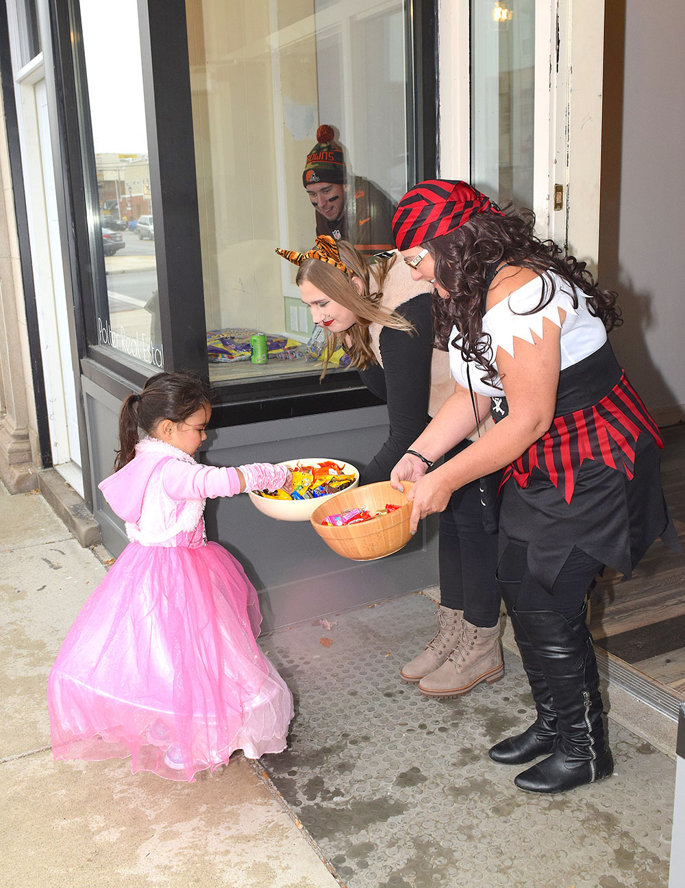 Kid gets candy for trick-or-treat