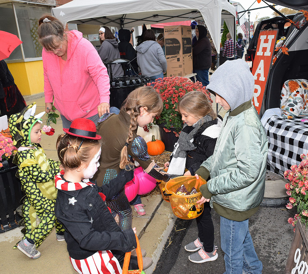 image of children and adults at a Halloween event