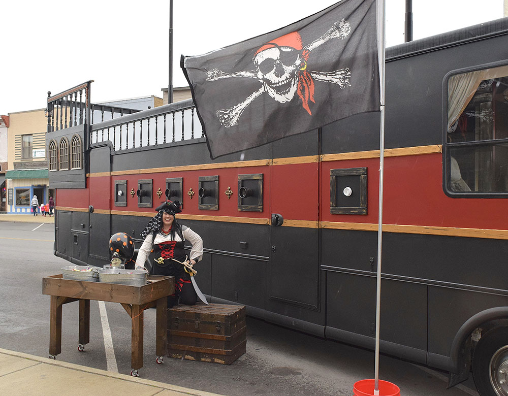 Image of a pirate ship themed RV and owner