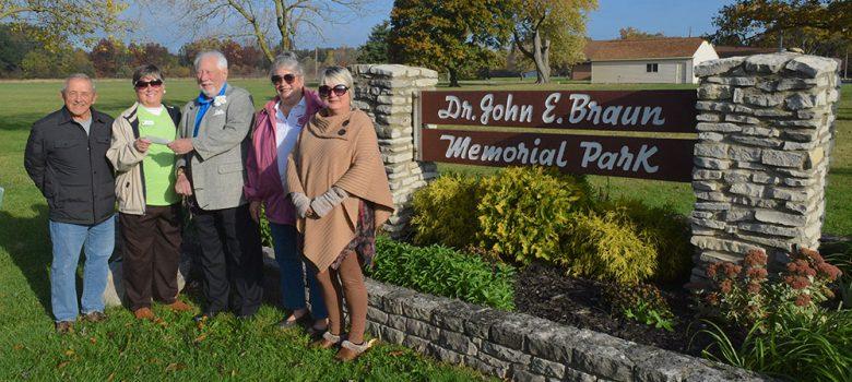 Members of the Catawba Island Garden Club present a check present $1,000 check to the beautification of Dr. John E. Braun Memorial Park