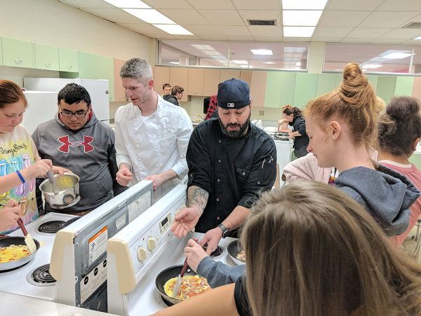 Catawba Island Club chefs teaching students to cook omelets