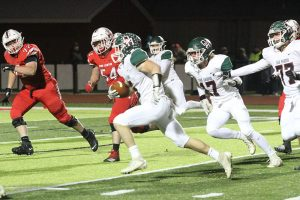 Clay Schulte of Oak Harbor running for touchdown
