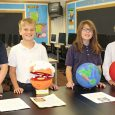 Students displaying homemade planets