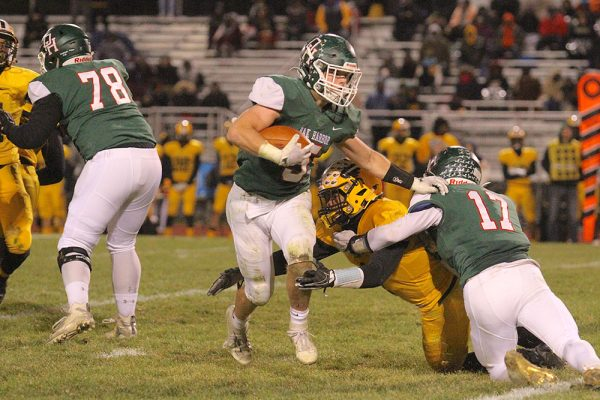 Clay Schulte runs the ball for Oak Harbor Rockets football team