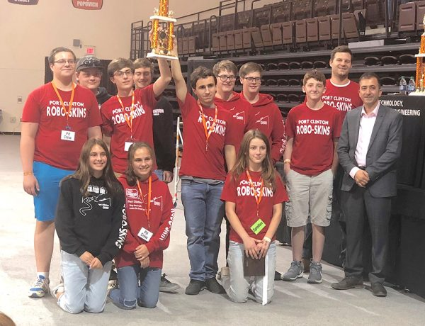 Port Clinton Robotics Team members, advisor, and BGSU representative pose with trophy