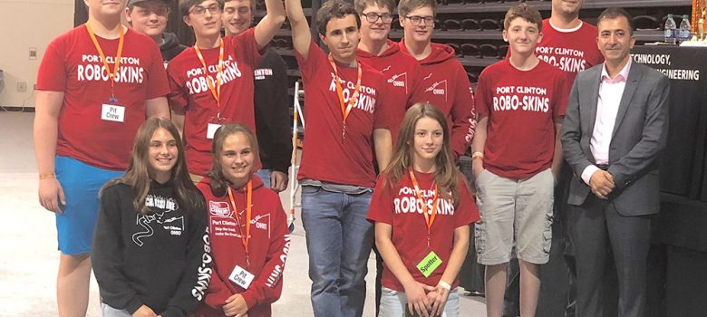 Port Clinton Robotics Team members, advisor, and BGSU representative pose with trophy