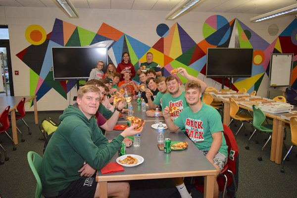Oak Harbor Rockets team members enjoy pizza