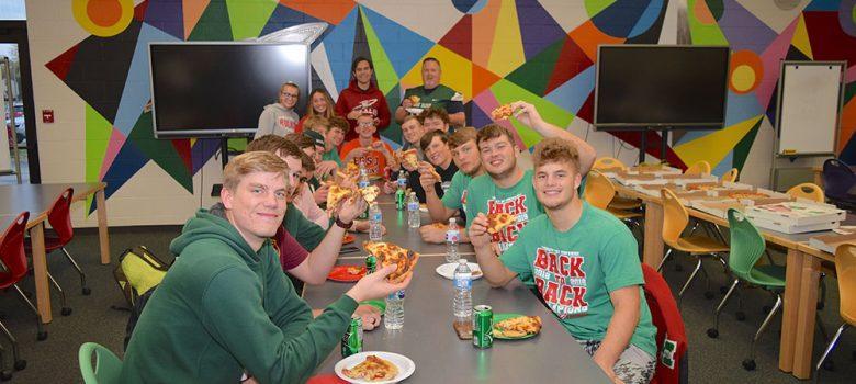 Oak Harbor Rockets team members enjoy pizza