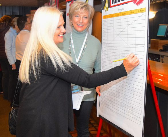 Volunteer signs up for bell-ringing the holiday season for the Salvation Army's Red Kettle Campaign