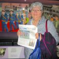 Peggy Debien poses with The Beacon at museum in England