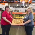 Image of Mary Priddy and Kim Branham holding a pizza from FriendShip Kitchen
