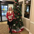 Jane Pittman stand next to Tree of Hope Christmas tree
