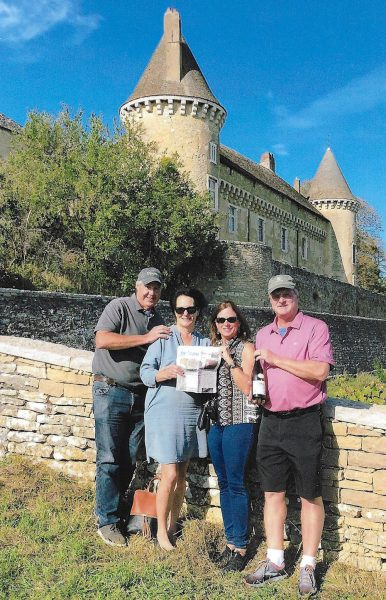 Quintin and Donna Smith and Ken and Carol Sander hold a copy of The Beacon in France