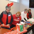 Salvation Army volunteers wrap toys for Christmas