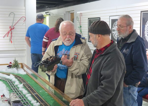 Image of a model train hobbyists talk about model train