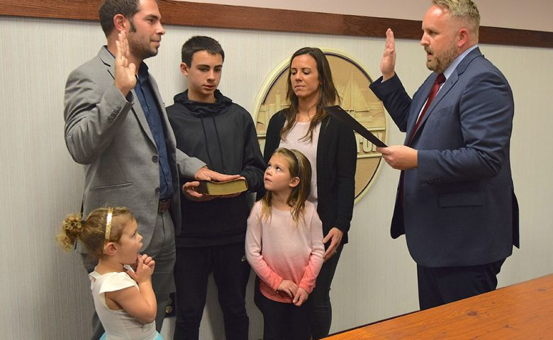 Auditor Cole Hatfield was sworn in by Gabe Below, Ward 4 Councilman.
