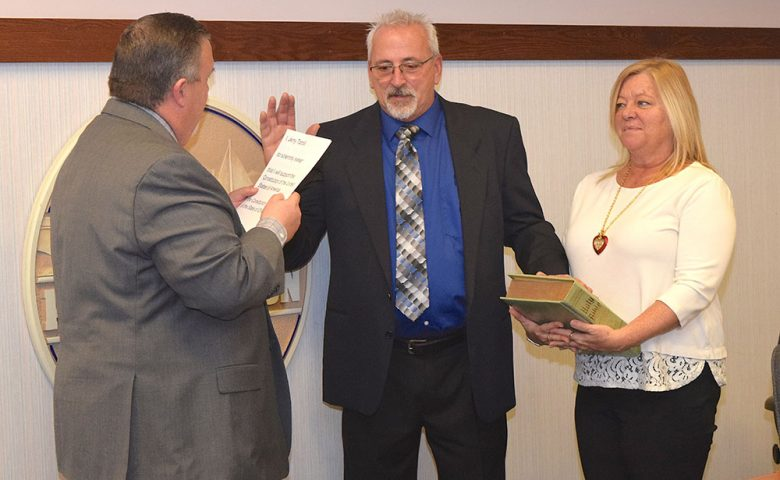 Council-at-Large Jerry Tarolli was sworn in by Port Clinton Mayor Mike Snider.
