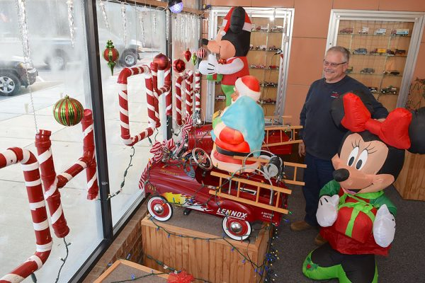 Image of Dave dubbert and the winning window holiday decoration contest at Ohler & Holzhauer