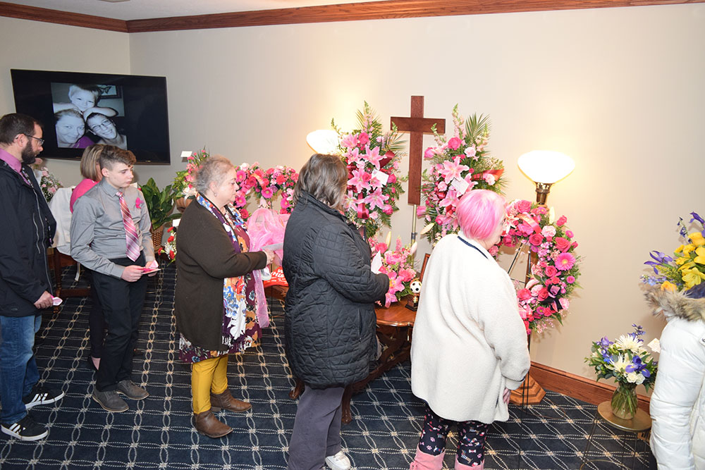 Family, friends, community gather to remember