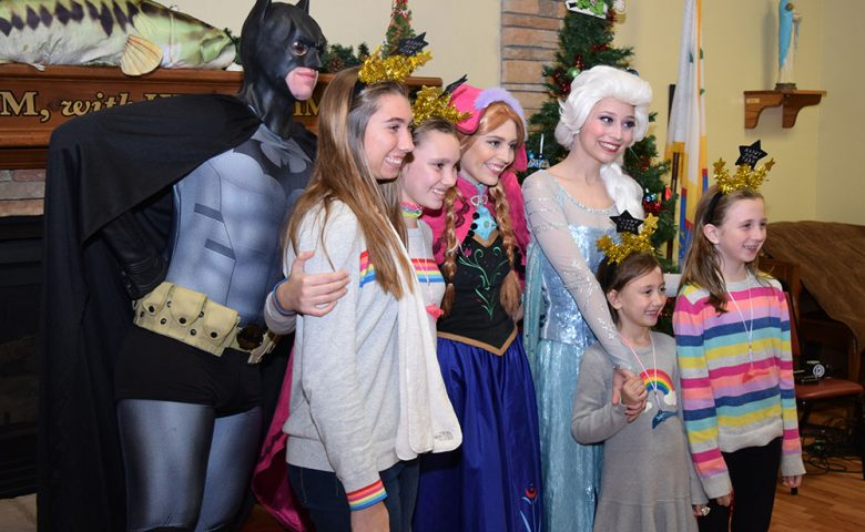 Image of kids, pretty princesses, and a very realistic Batman