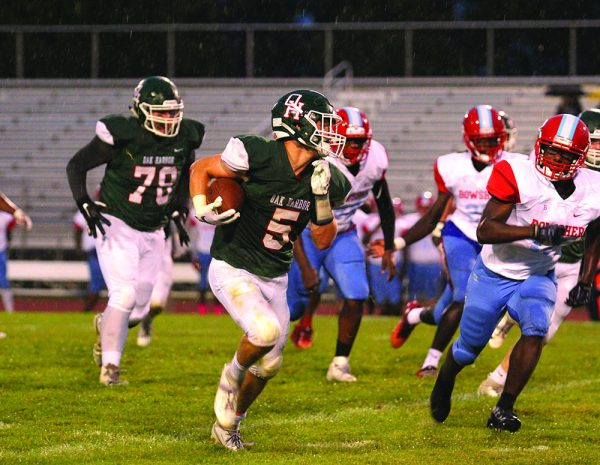 Image of Clay Shulte of the Oak Harbor Rockets running with the football during a game