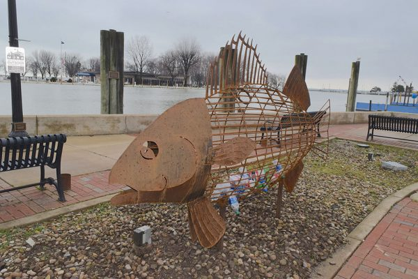 Image of a fish shaped plastic receptacle in Port Clinton
