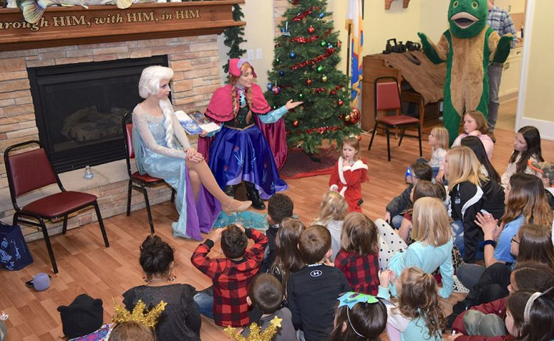Image of kids listeing during story time at the Minnow Drop