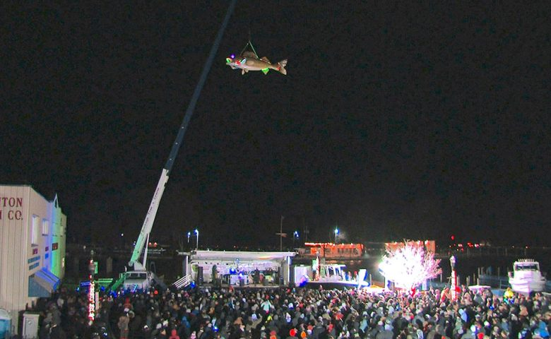 Image of crowd and Wylie the Walleye during New Years celebration