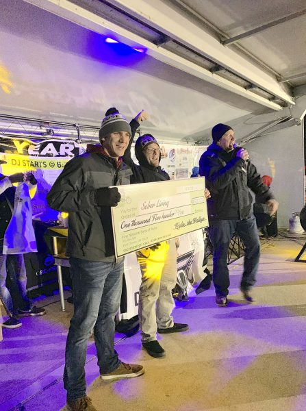 Image of crew from Lighthouse Sober Living House holding big check at 2020 Walleye drop