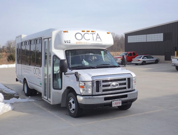 Image of a white OCTA bus