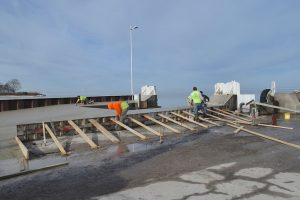 Image of workers constructing dock renovations