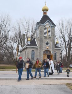Parishioners and celebrants from around the area march from Holy Assumption Church on Main Street in Marblehead to Clemons park on Saturday for the 2nd annual Blessing of Lake Erie.