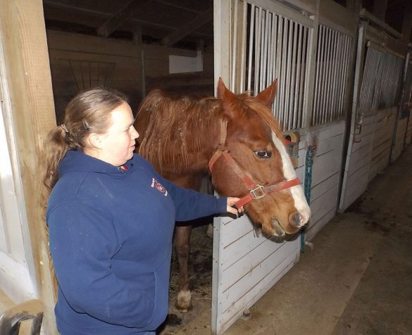 Image of Lindsay Bille with a horse