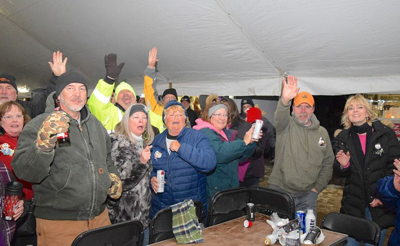 Image of partygoers in large tent at the Burning Snowman event