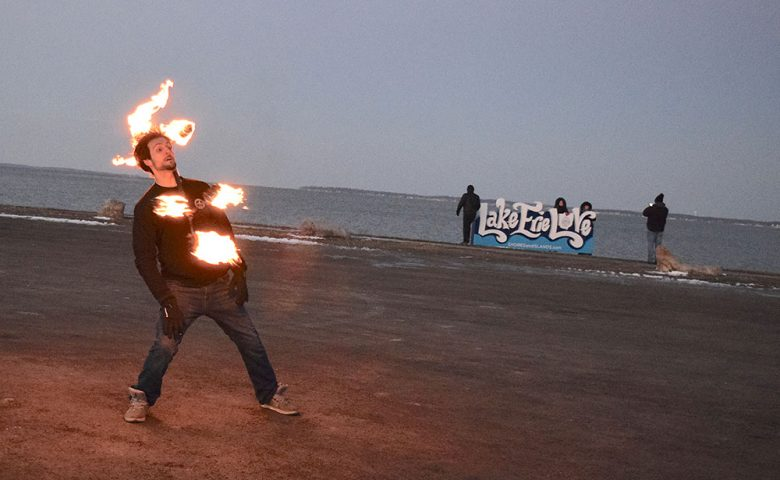 Image of man Juggling fire