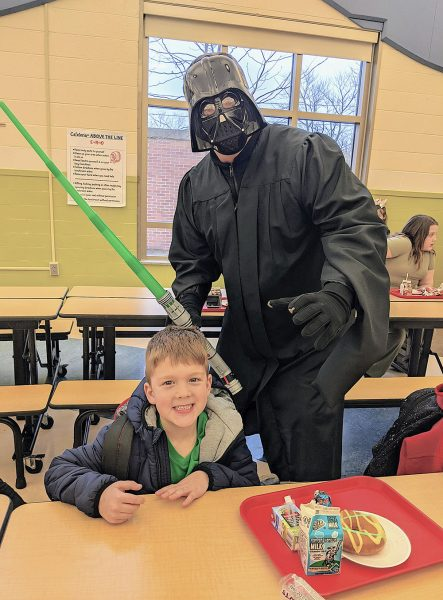 Image of student and Darth Vader
