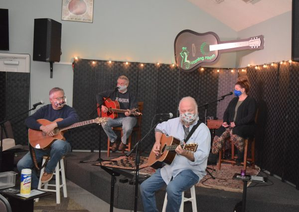 Featured in their masked, socially-distancing are Port Clinton musicians (left to right) Jerry Davenport, Ron Miller, Ron Nisch and Frankie Priest Bickel.