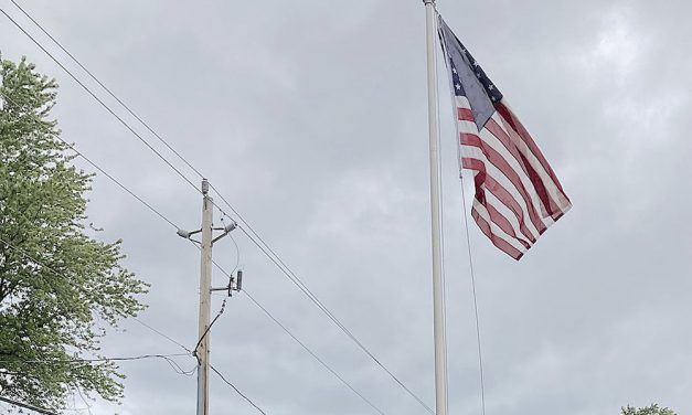 New U.S. flag, trustees honor vets at Cottages of Marblehead