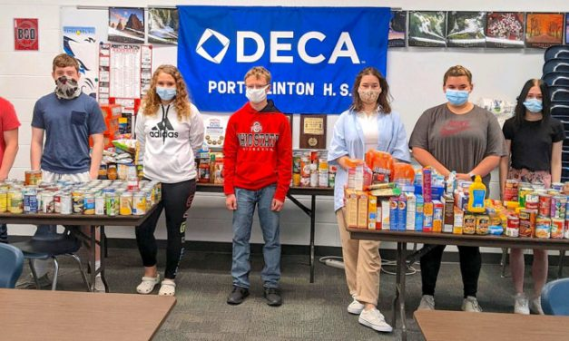 Port Clinton DECA 'Cans for Donuts' drive stocks shelves