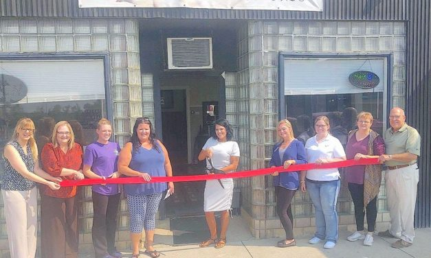 Twisted Sheers cuts ribbon at new location