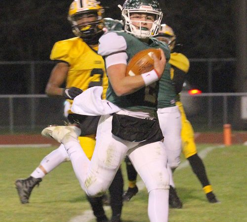 Oak Harbor Rockets football player runs with the ball