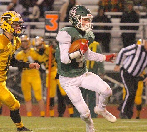 Tyler May running the ball for Oak Harbor Rockets football team